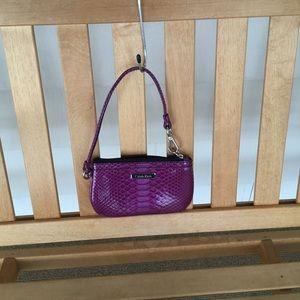 Calvin Klein purple fuchsia snake skin wristlet
